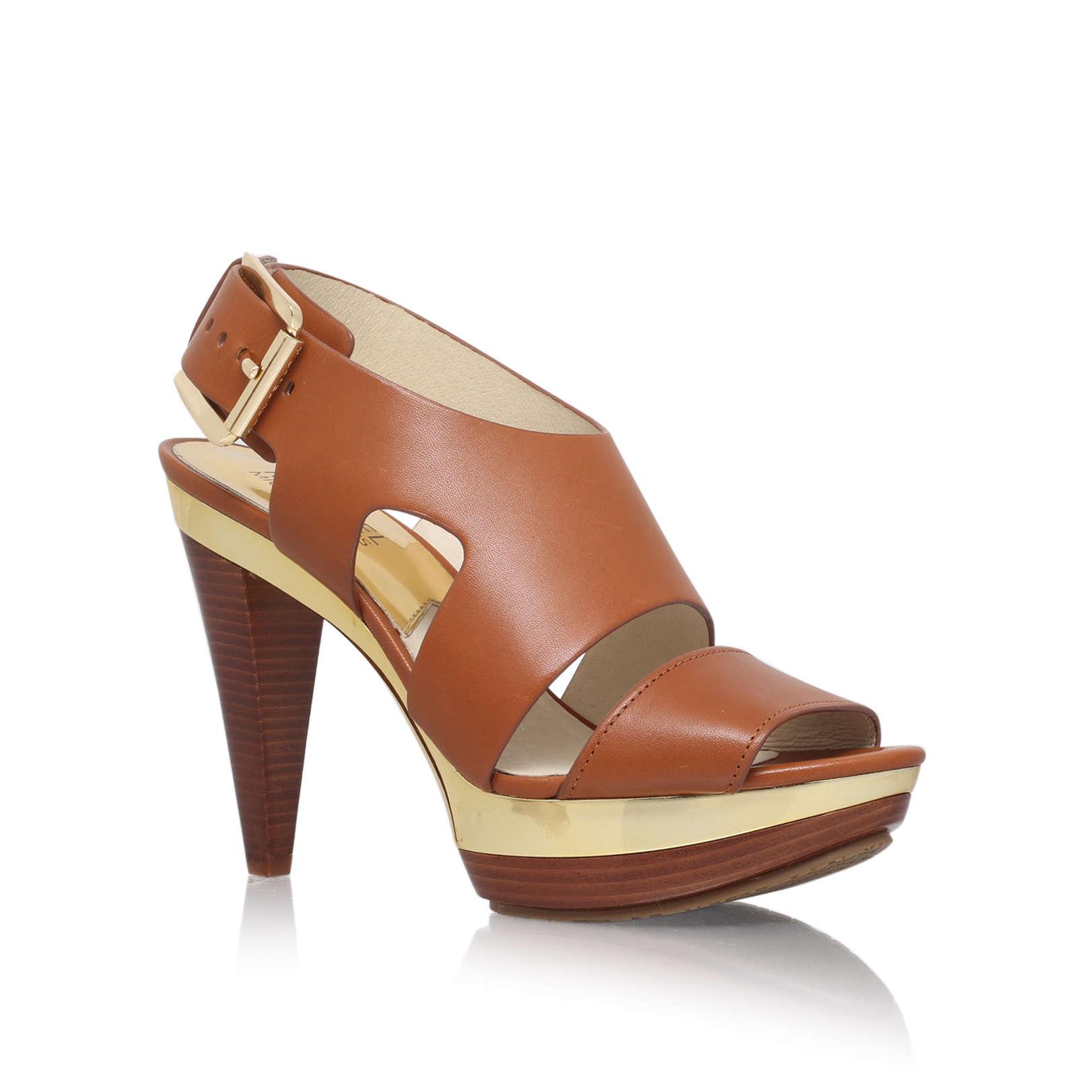 ce8609c0ea713 CARLA PLATFORM Michael Michael Kors Carla Platform Brown Leather Mid Heel  Sandals by MICHAEL MICHAEL KORS