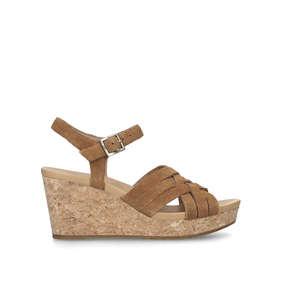 4529beb78900b8 Uma. Tan Suede Wedge Sandals