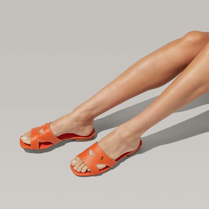 2229d4529a2 Odina Orange Flat Slip On Sandals By Kurt Geiger London | Kurt Geiger