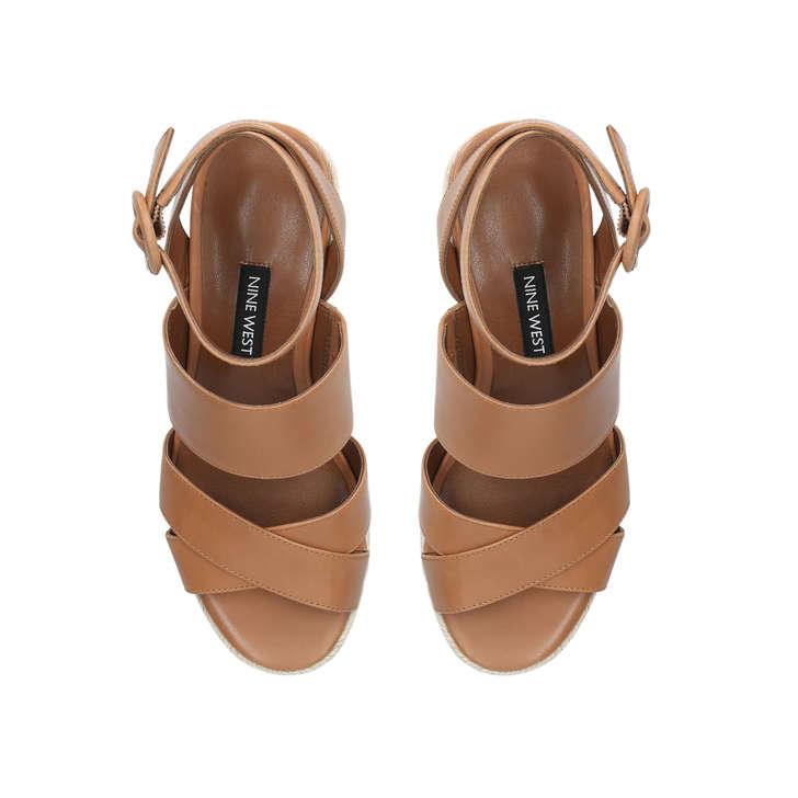c6c57f037ef5 Kushala Tan Wedge Sandals By Nine West