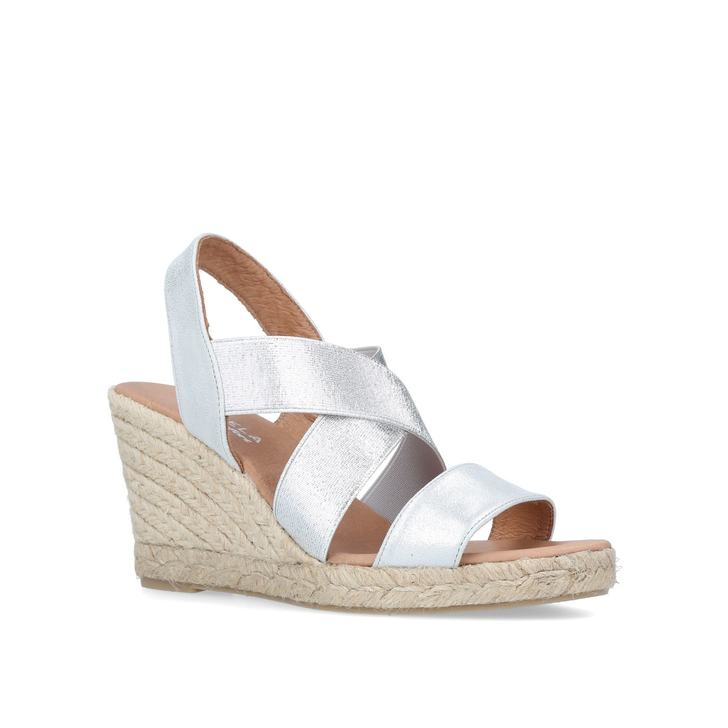 0a810daec9a Shady Metallic Mid Heel Wedge Sandals By Carvela Comfort