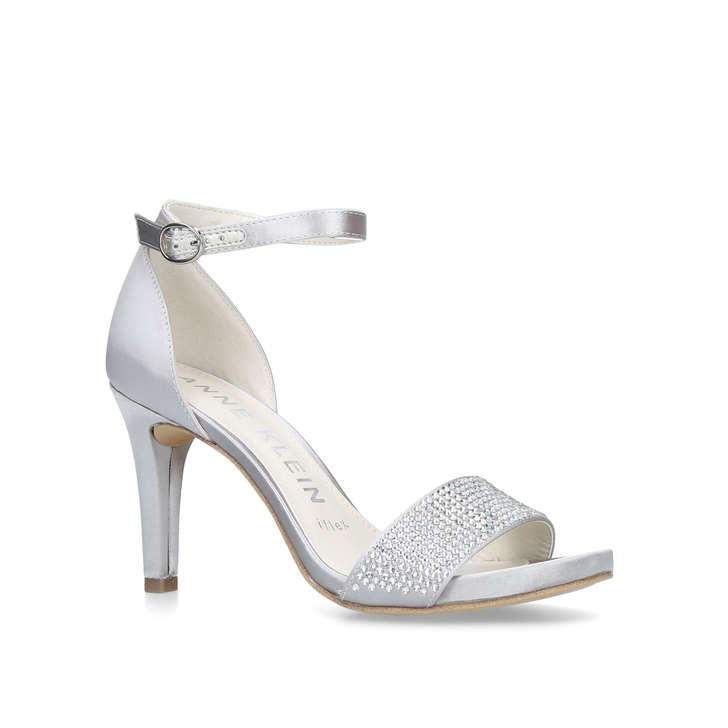 31e8a23dea4 Odree Metallic Silver Studded Strappy Sandals By Anne Klein