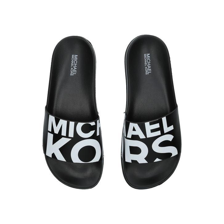 ba09bec70753 Gilmore Slide Black And White Sliders By Michael Michael Kors