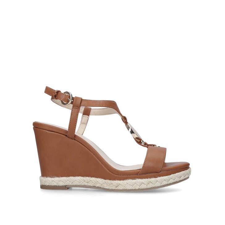 b4e2e66dc3 Glaze Tan Patent Wedge Heel Sandals By Nine West | Kurt Geiger