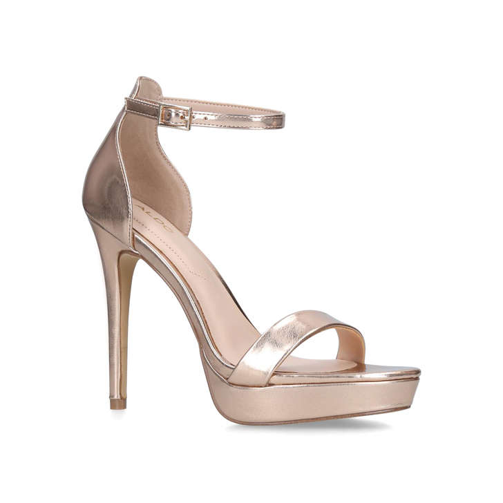 cab9aca3312 Madalene Gold Platform Stiletto Heel Sandals By Aldo