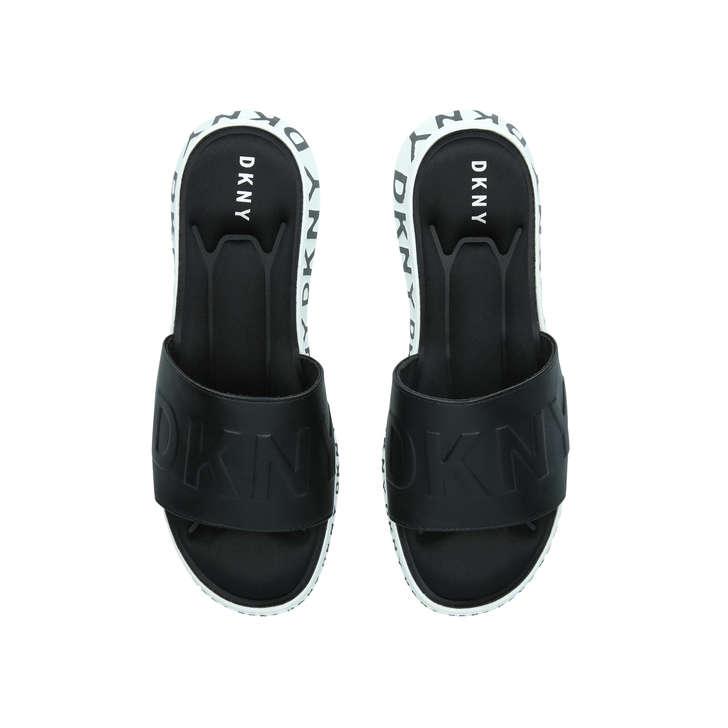 e42151947e Mara Monochrome Leather Wedge Sliders By DKNY | Kurt Geiger