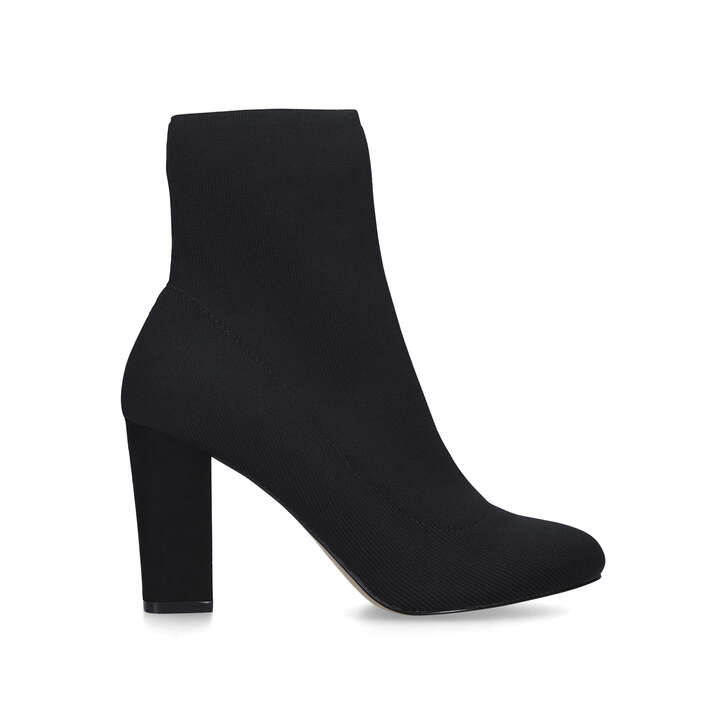 TRAVEL Black Block Heel Sock Boots by