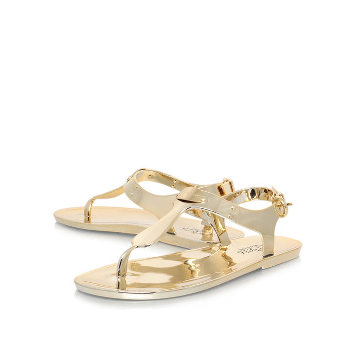 5d744a84cfa Mk Plate Jelly Gold Flat Sandals By Michael Michael Kors