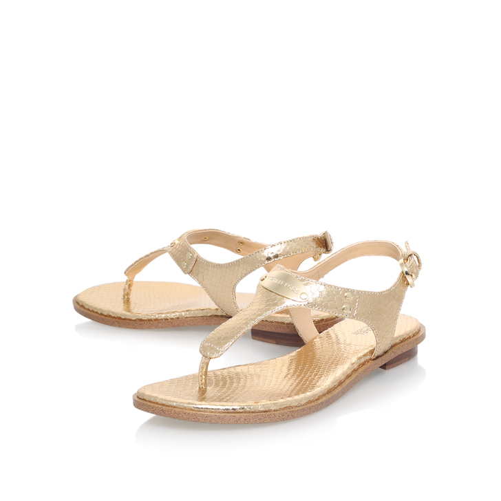 cf83994d023 Mk Plate Thong Gold Flat Sandals By Michael Michael Kors