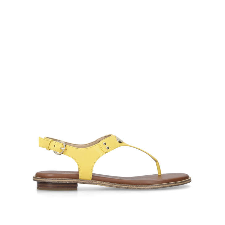 8bd5b9cb4b4 Mk Plate Thong Yellow Leather Flat Sandals By Michael Michael Kors ...